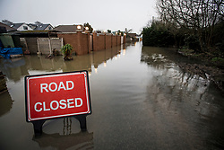 © Licensed to London News Pictures. 03/02/2021. Laleham, UK. A residential street flooded in Laleham, Surrey where water levels along the Thames have risen over night. Large parts of the UK experience more wet conditions which is expected to bring further flooding. Photo credit: Ben Cawthra/LNP