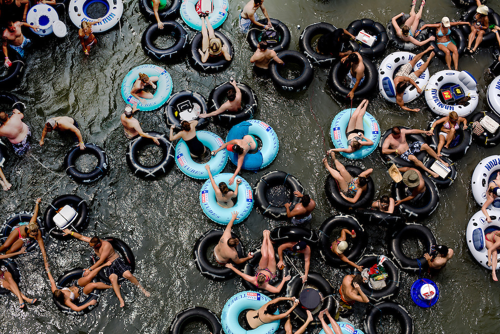 Tubers make their way down the Comal River near Prince Solms Park on Memorial Day in New Braunfels, Texas.