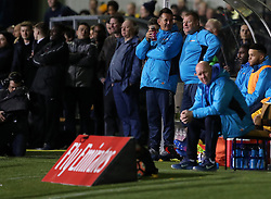 Sutton substitute goal keeper Wayne Shaw and manager Paul Doswell during the Emirates FA Cup, Fifth Round match at Gander Green Lane, London.