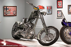 Eddie Trotta's Thunder Cycle single-sided Softailwith an H&L 131ci engine in Michael Lichter's Skin & Bones tattoo inspired Motorcycles as Art show at the Buffalo Chip Gallery during the annual Sturgis Black Hills Motorcycle Rally.  SD, USA.  August 10, 2016.  Photography ©2016 Michael Lichter.