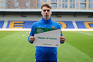 AFC Wimbledon defender Dan Csoka (3) holding level playing field sign  during the EFL Sky Bet League 1 match between AFC Wimbledon and Gillingham at Plough Lane, London, United Kingdom on 23 February 2021.