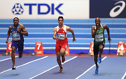 USA's Christian Coleman (left), Malta's Jacob Al Aida (centre) and St Kitts and Nevis' Kim Collins in action during day three of the 2018 IAAF Indoor World Championships at The Arena Birmingham.