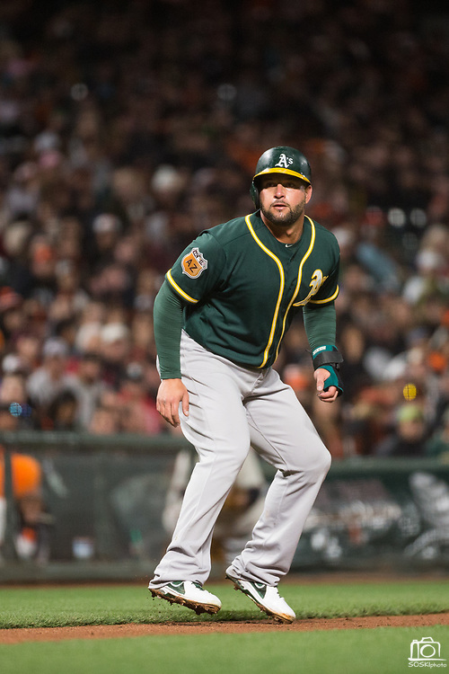 Oakland Athletics first baseman Yonder Alonso (17) leads off third base against the San Francisco Giants at AT&T Park in San Francisco, California, on March 30, 2017. (Stan Olszewski/Special to S.F. Examiner)