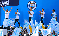 (left to right) Manchester City manager Pep Guardiola, Mikel Arteta, Rodolfo Borrell, Xabi Mancisidor and Carles Planchart on stage during the trophy parade in Manchester.