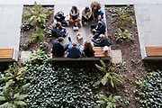 An aerial view of a group of young people sitting with their lunches in the City of London, the capitals financial district, on 21st September 2021, in London, England. Post-Covid pandemic, City workers are returning to their office desks in greater numbers but many still prefer to work from home for at least 1-2 days a week.