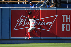 May 31, 2018 - Los Angeles, CA, U.S. - LOS ANGELES, CA - MAY 31: Philadelphia Phillies Center field Odubel Herrera (37) bangs into the wall after coming up with a spectacular catch during a MLB game between the Philadelphia Phillies and the Los Angeles Dodgers on May 31, 2018 at Dodger Stadium in Los Angeles, CA. (Photo by Brian Rothmuller/Icon Sportswire) (Credit Image: © Brian Rothmuller/Icon SMI via ZUMA Press)