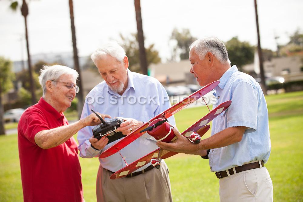 A Group of Senior Friends Enjoying Model Airplane