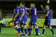 AFC Wimbledon striker Dominic Poleon (10) scores a goal 3-0 and scores and celebrates with team during the EFL Trophy match between AFC Wimbledon and U23 Swansea City at the Cherry Red Records Stadium, Kingston, England on 30 August 2016. Photo by Stuart Butcher.