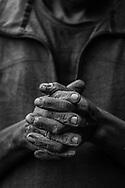 Clutched hands of a Batwa elder in Bwindi, Uganda.
