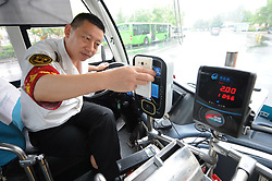 July 2, 2017 - Qingdao, Qingdao, China - Qingdao, CHINA-July 2 2017: (EDITORIAL USE ONLY. CHINA OUT)..Multiple mobile payments will be accepted on public buses in Qingdao, making the city the first in China to have various ways of mobile payment on bus. Passengers can pay bus fares through various ways of mobile payment including Wechat and Applepay. (Credit Image: © SIPA Asia via ZUMA Wire)