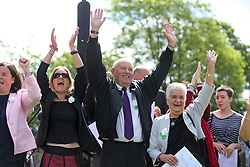 © Licensed to London News Pictures. 16/06/2017. Birstall, UK.  L to R Jo Cox's sister Kim leadbeater, father Gordon Leadbeater and mother Jean Leadbeater, cheering during the ceremony.  500 school children from nine schools in the Birstall area that have joined together in Heckmondwike Green to sing songs in memory of MP Jo Cox this morning. Today marks the one year anniversary of the death of Labour MP for Batley & Spen Jo Cox. Jo Cox died after being shot & stabbed by Thomas Mair outside Birstall library where she had been due to hold a constituency surgery. Photo credit: London News Pictures