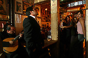 """Singer Pedro Moutinho performing at """"Tasca do Chico"""" , one of the typical spots were to see live perfomances of Fado music and were the audience can spontaneously participate and also ask to sing. It is located in  Bairro Alto neighborhood."""