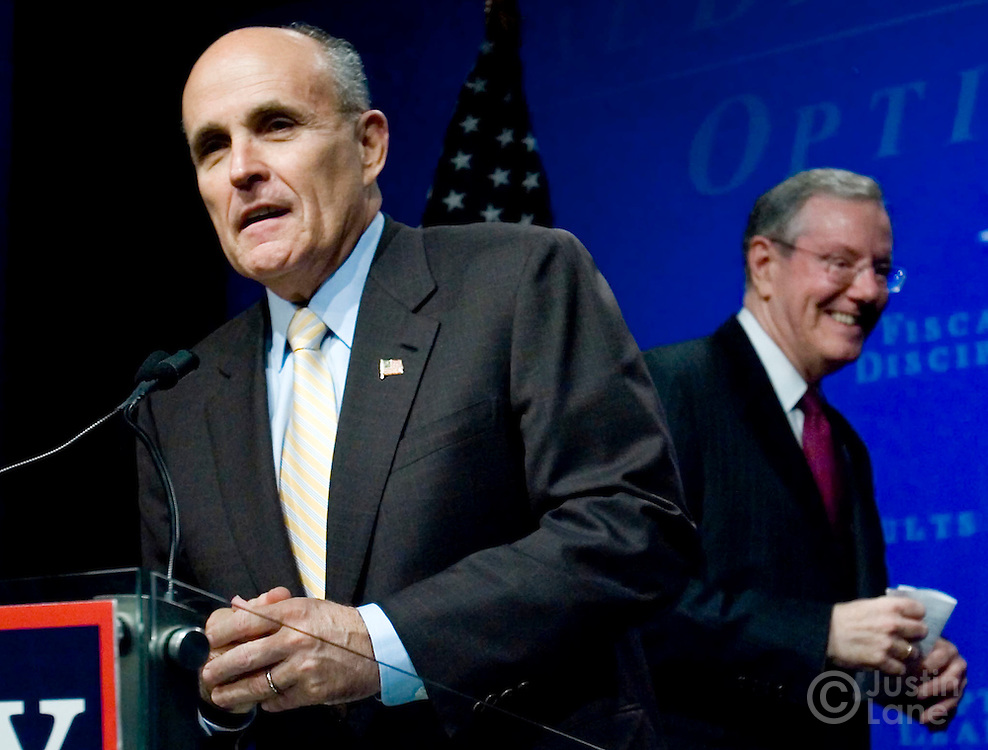 US Presidential candidate Rudolph Giuliani (L) speaks during a press conference with Steve Forbes (R) at the NASDAQ stock exchange where Forbes announced that he was endorsing Giuliani's run to be President of the United States in New York, New York on Wednesday 28 March 2007.