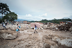 April 3, 2017 - Mocoa,  Colombia - People carry their belongings in a zone affected by the landslide. Rescue work keeps on going in Colombia's southwest city of Mocoa, in the department of Putumayo, early Sunday, following a tragic mudslide that devastated 17 neighborhoods and killed 207. (Credit Image: © Juan Zarama Perini/Xinhua via ZUMA Wire)