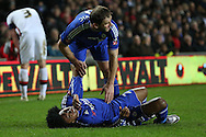 Willian of Chelsea lies injured as Branislav Ivanovic of Chelsea attends to him after the Chelsea player was stamped on. The Emirates FA cup, 4th round match, MK Dons v Chelsea at the Stadium MK in Milton Keynes on Sunday 31st January 2016.<br /> pic by John Patrick Fletcher, Andrew Orchard sports photography.