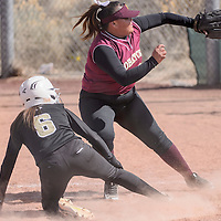 Tohatchi Cougar Garalynn Wood (32) reaches for the ball as Raton Tiger Estrella Vargas (6) slides home Friday at Tohatchi High School.