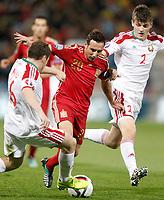 Spain's Santi Cazorla (c) and Belarus' Sergei Balanovich (l) and Stanislav Dragun during 15th UEFA European Championship Qualifying Round match. November 15,2014.(ALTERPHOTOS/Acero)