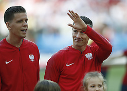 MOSCOW, June 19, 2018  Robert Lewandowski (R) of Poland is seen prior to a Group H match between Poland and Senegal at the 2018 FIFA World Cup in Moscow, Russia, June 19, 2018. (Credit Image: © Cao Can/Xinhua via ZUMA Wire)