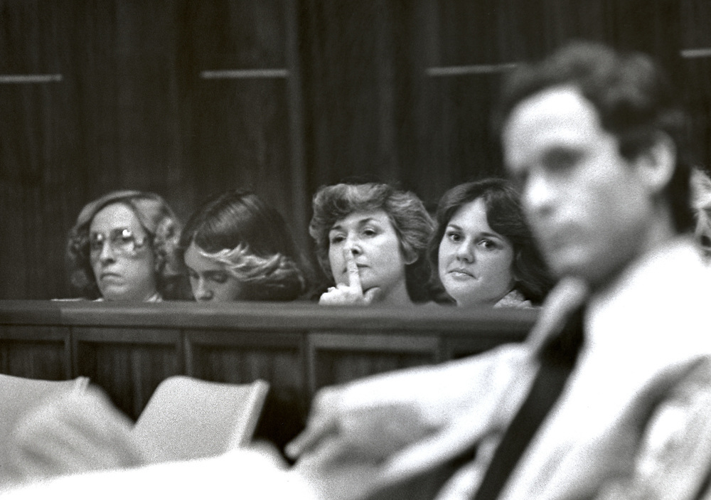 Ted Bundy Murder Trial - Miami - Scores of young women arrive at the courthouse early each morning trying to be admitted to the Ted Bundy Trial and if luck would have it - the front row of the courtroom behind Bundy. Some accounts referred to some of the women as Bundy's Groupies. Theodore Robert Bundy was an American serial killer, kidnapper, rapist, burglar, and necrophile who assaulted and murdered numerous young women and girls during the 1970s and possibly earlier. After more than a decade of denials, he confessed to 30 homicides that he committed in seven states between 1974 and 1978.