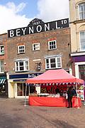 Market stalls in Market Place next to Beynon building, Newbury, Berkshire, England, UK