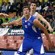 Efes Pilsen's Dusan CANTEKIN (B) and Antalya BSB's Patrick FEMERLING (F) during their Turkish Basketball league match Efes Pilsen between Antalya BSB at the Ayhan Sahenk Arena in Istanbul Turkey on Wednesday 21 April 2010. Photo by Aykut AKICI/TURKPIX