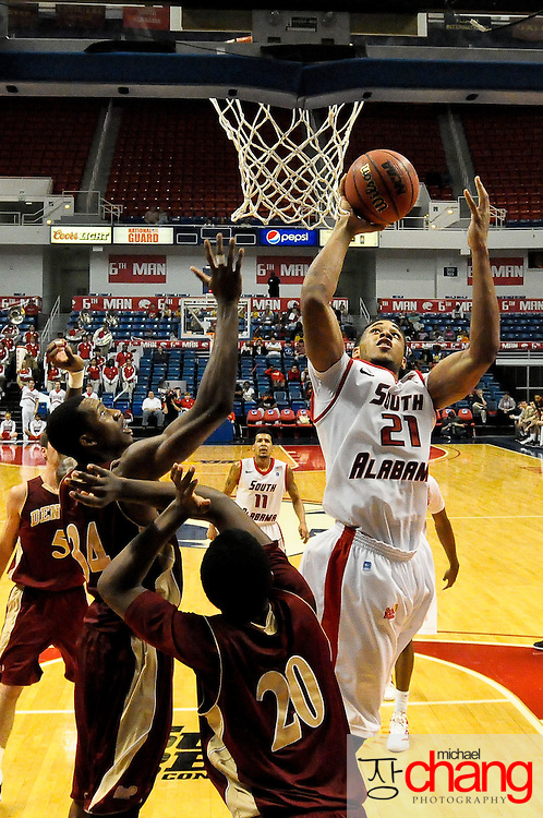 South Alabama's forward Augustine Rubit (21) shoots over Denver's forward, Royce O'Neale (20) and Chris Udofia (34),  in the second half of play in Mobile, AL. Denver defeated South Alabama 67-50 on January 7, 2012.