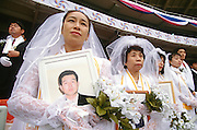 Approximately 30,000 couples get married in a Unification Church mass wedding ceremony at RFK Stadium November 29, 1997 in Washington, DC.  (Photo Richard Ellis)