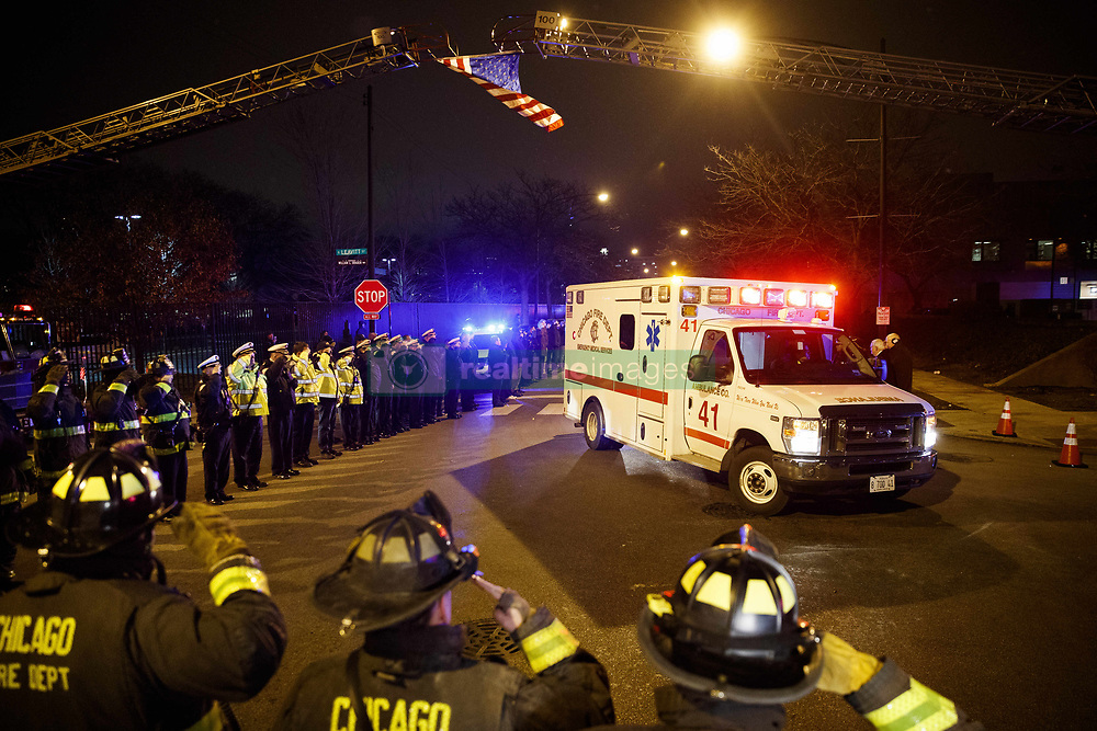 November 19, 2018 - Chicago, IL, USA - Police and firefighters salute as an ambulance arrives at the medical examiners office carrying the body of an officer who was killed during a shooting at Mercy Hospital which left four people, including the gunman, dead Monday Nov. 19, 2018 in Chicago. (Credit Image: © Armando L. Sanchez/Chicago Tribune/TNS via ZUMA Wire)