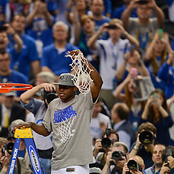 Apr 2, 2012; New Orleans, LA, USA; Kentucky Wildcats guard Darius Miller (1) raises the net after defeating the Kansas Jayhawks 67-59 in the finals of the 2012 NCAA men's basketball Final Four at the Mercedes-Benz Superdome. Mandatory Credit: Derick E. Hingle-US PRESSWIRE