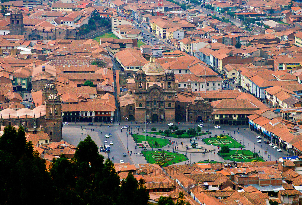 Young people gather in Plaza de Armas  square by the fountain in Cuzco, the ancient capital of the Inca Empire, Peru, South America