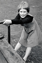 Girl in playground, Nottingham UK 1982