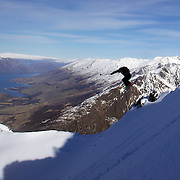 Freeskier Chris Booth of Australia launches off a drop during the World Heli Challenge Freestyle Day at Mount Albert on Minaret Station, Wanaka, New Zealand. 31st July 2011