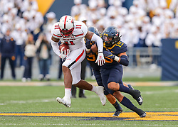 Nov 9, 2019; Morgantown, WV, USA; Texas Tech Red Raiders tight end Donta Thompson (11) catches a pass while West Virginia Mountaineers safety Noah Guzman (19) during the third quarter at Mountaineer Field at Milan Puskar Stadium. Mandatory Credit: Ben Queen-USA TODAY Sports