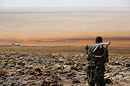 An Ethiopian Army scout makes his way back to the Land Cruiser at Dallol