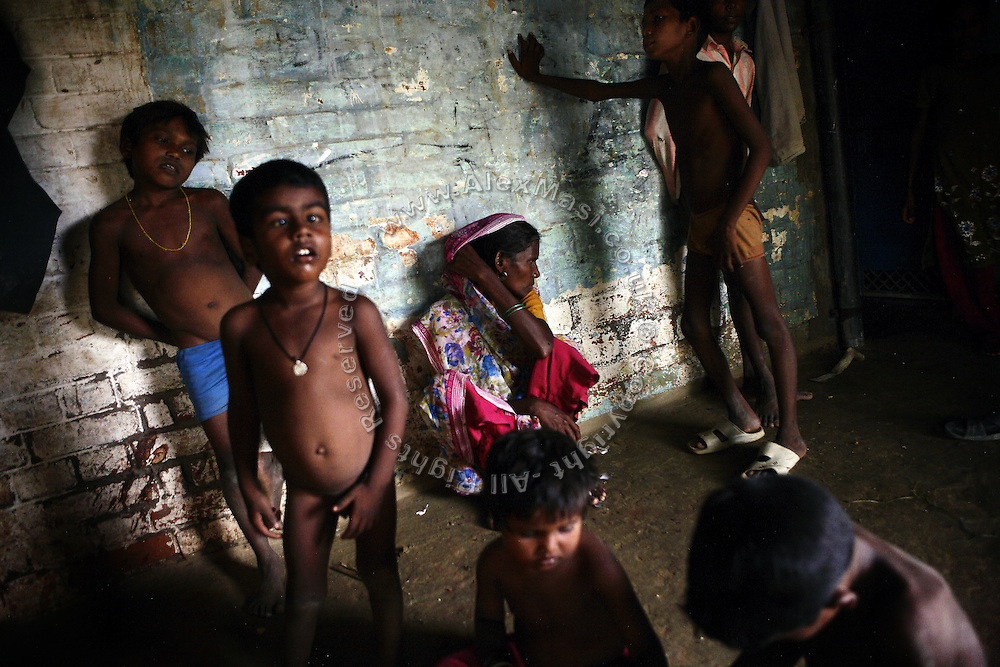 A child with a neurological disorder (2nd from left) is portrayed with his underprivileged family inside their rudimental home in Joana, pop. 1800, Kanpur, Uttar Pradesh, a poor agricultural village affected by the tanneries' untreated water discharge in the Ganges River.