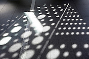 abstract dots pattern on floor from sunlight