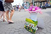 A flower vendor's wares brighten up the sidewalk near Teatralnaya Ploschad in St. Petersburg, Russia.