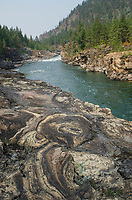 Kootenai River at Kootenai Falls in northwestern Montana. Large stromatolites are visible in the foreground rocks.