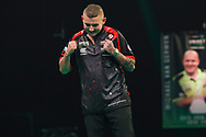 Nathan Aspinall hits a double and wins his semi-final match against Peter Wright during the Unibet Premier League Play-Offs at the Ricoh Arena, Coventry, England on 15 October 2020.
