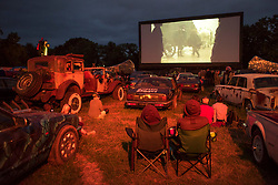 Festival goers watch a film at Cineramageddon drive-in cinema, during the Glastonbury Festival at Worthy Farm in Pilton, Somerset. Picture date: Thursday June 22nd, 2017. Photo credit should read: Matt Crossick/ EMPICS Entertainment.