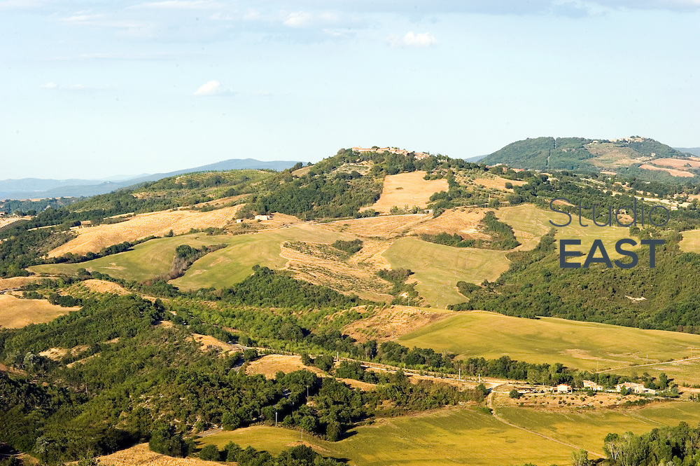 TUSCANY, ITALY - AUGUST 10: A view of the hilly landscape on August 10, 2012, in Tuscany, Italy. Tuscany is a region in central Italy known for its landscapes, traditions, history, artistic legacy and its influence on high culture, making it a popular tourist destination that attracts millions of tourists every year. It is regarded as the birthplace of the Renaissance. (Photo by Lucas Schifres/Getty Images)