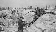 World War I 1914-1918: French soldiers in trench taken from  Germans in woodland at Mesnil-les-Haut, France, reduced to skeletons  trees by gunfire. From 'Le Flambeau', Paris, September 1915. Bombardment Destruction