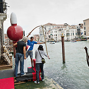 """VENICE, ITALY - JUNE 02: Finishing touches on """"Fishing Rabbit"""" an installation by No2Good facing the Grand Canal and part of the Exhibition Future Pass on June 2, 2011 in Venice, Italy. The Venice Art Biennale will run from June 4 to November 27, 2011."""