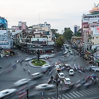 Traffic swirls around a roundabout in Ho Chi Minh City, Vietnam.