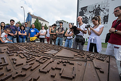 Tour group studiest route of Berlin Wall from model at memorial park on Bernauer Strasse in Berlin Germany