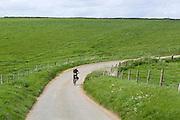 A woman is cycling near Rievaulx, Yorkshire, England, United Kingdom.