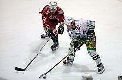 Jurij Golicic of Jesenice and Tomaz Vnuk of Olimpija at ice hockey match Acroni Jesencie vs ZM Olimpija in second round of final of Slovenian National Championship,  on April 5, 2008 in Arena Podmezaklja, Jesenice, Slovenia. Acroni Jesenice won the game 6:1 and lead the series 2:0.  (Photo by Vid Ponikvar / Sportal Images)