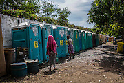 Female survivors of the Zamboanga City rebel attack go to the segregated restrooms in the city's largest stadium in Zamboanga, Mindanao, The Philippines on November 4, 2013. SPRINT-IPPF partner NGO FPOP has advocated and implemented gender segregated restrooms to try to reduce gender based violence cases such as rape. Photo by Suzanne Lee for SPRINT-IPPF
