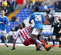 Photo: Mark Stephenson.<br /> Birmingham City v Stoke City. Coca Cola Champinship. 11/02/2007.Birmingham's Fabrice Muamba win's the ball from Stoke's Ricardo Fuller