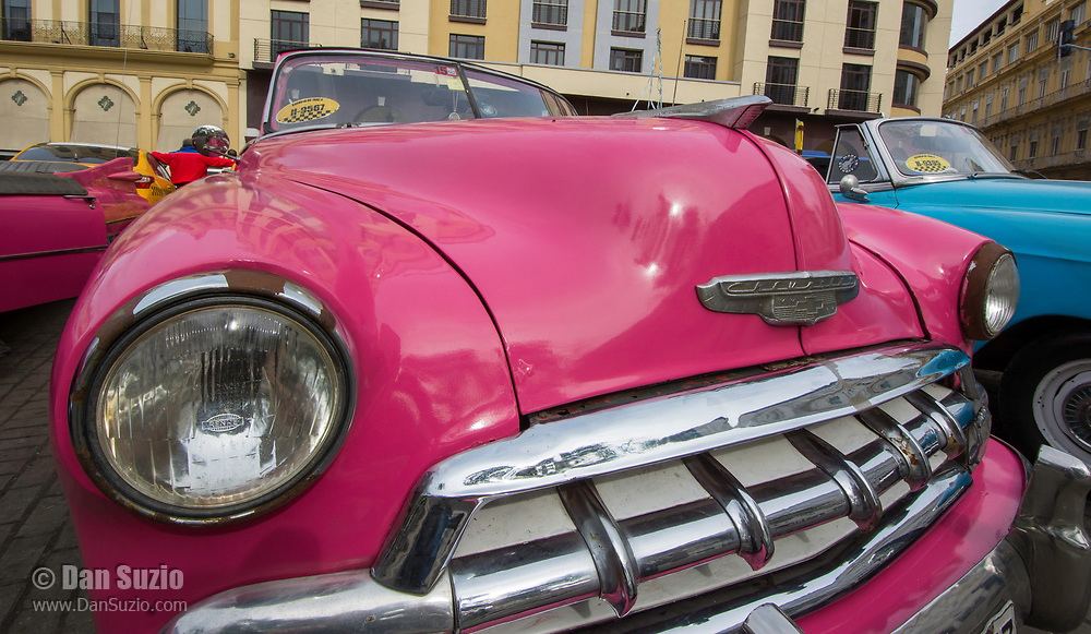 Havana, Cuba - Taxis wait for fares in front of Hotel Parque Central (Central Park). Classic American cars from the 1950s, imported before the U.S. embargo, are commonly used as taxis in Havana.